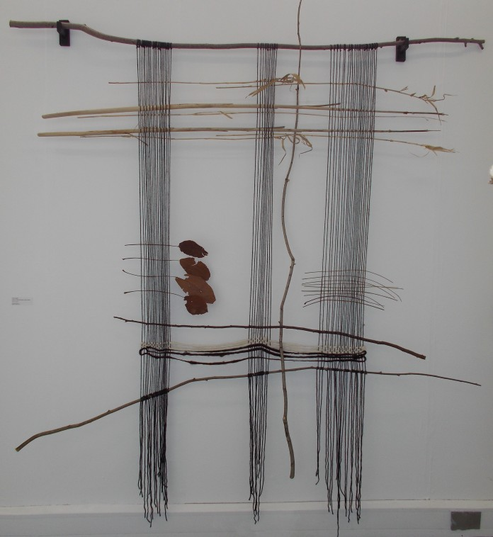 Large wall hanging made branches and hand woven wool